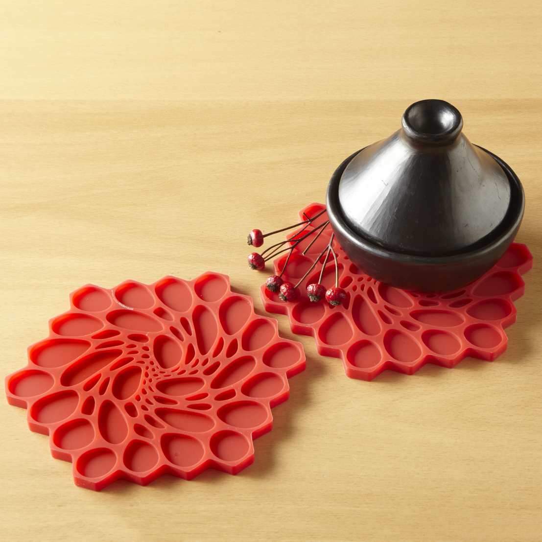 hive trivets – now for sale  nervous system blog - the overall shape is based on a hexagon so the trivets tile seamlesslybut they have a serrated edge that allows you to leave gaps and form more