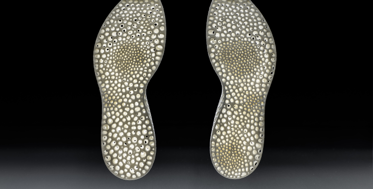The midsole on the left is generated from the underfoot pressure data of a person who runs with a midfoot strike and the right midsole is generated from heel strike data.