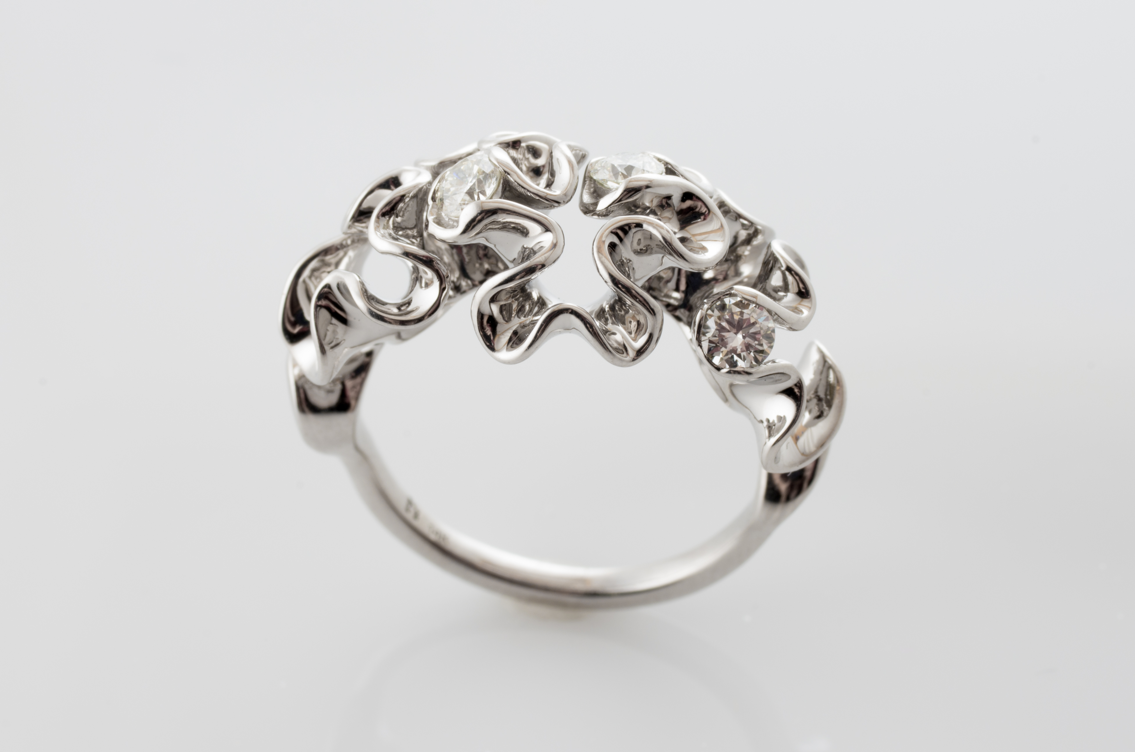 custom engagement rings made with code 3D printing and diamonds
