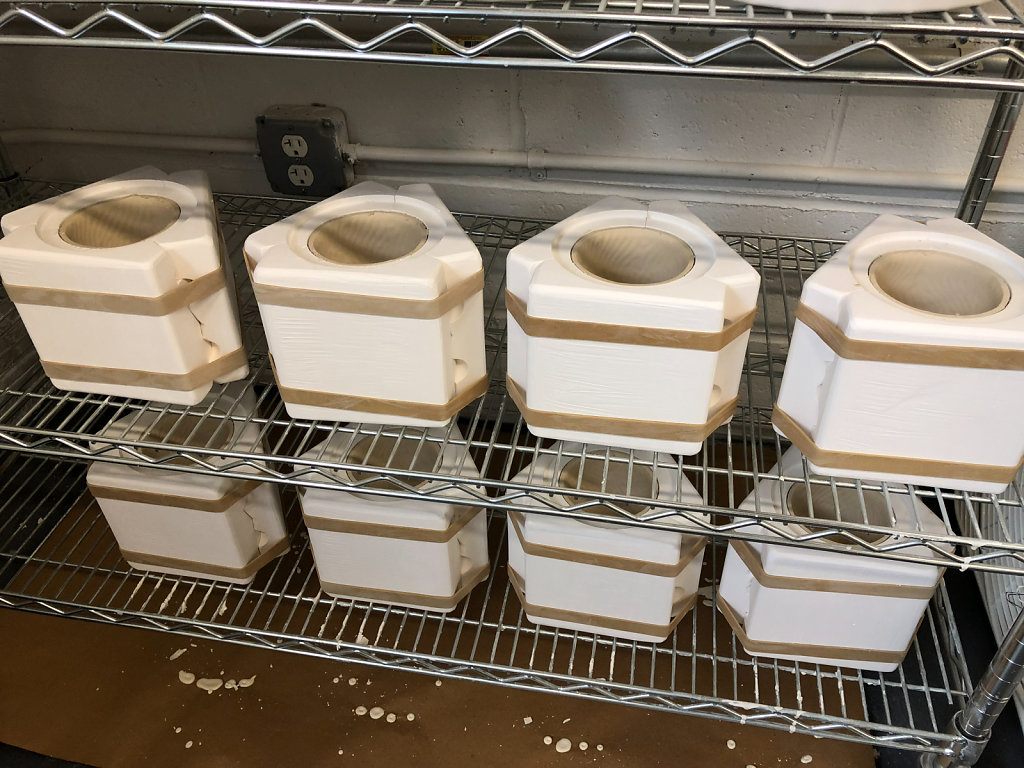 Porcelain cups drying in the molds